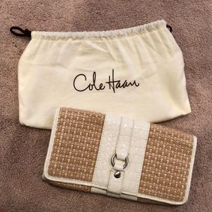 Beautiful white and woven Cole Haan clutch purse